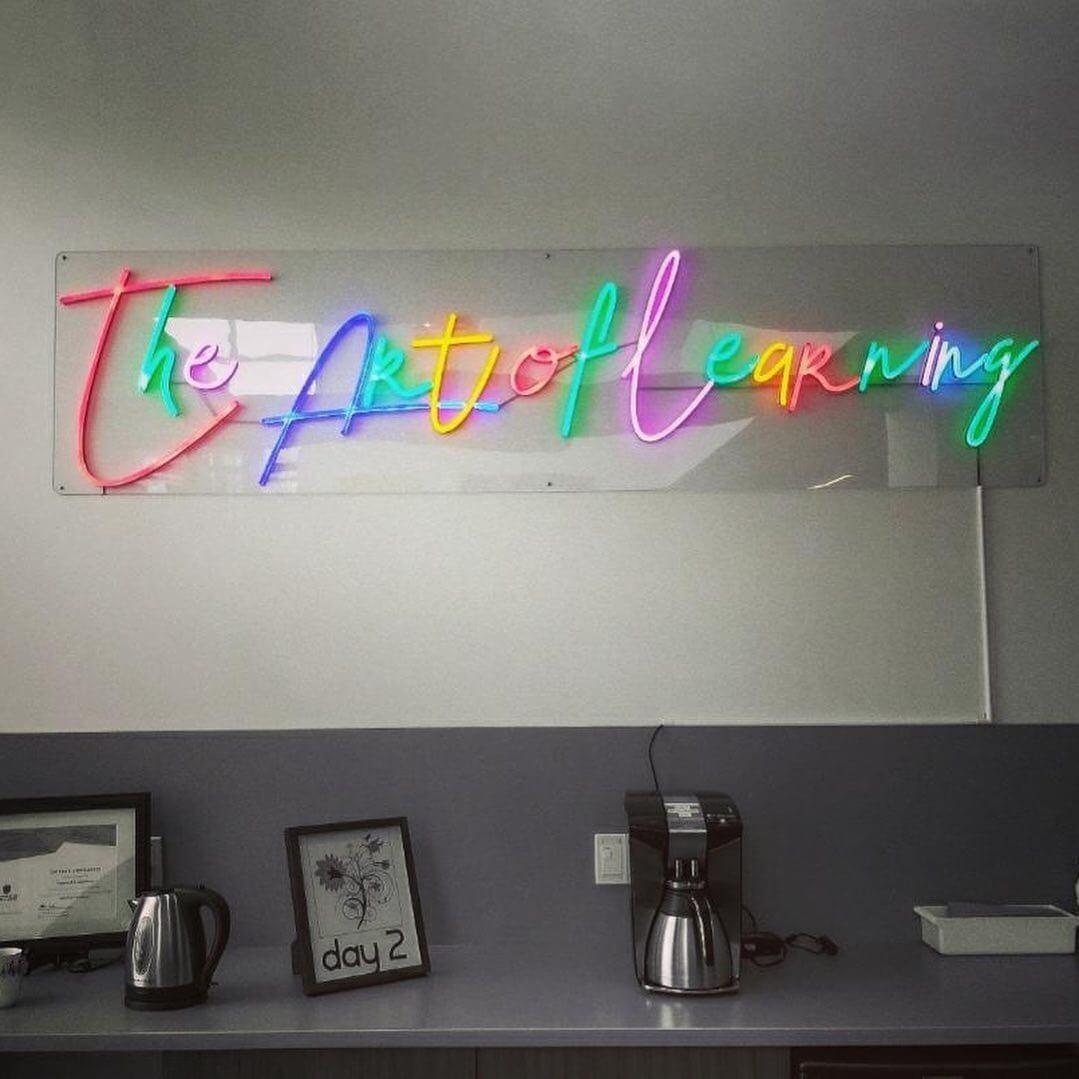 Custom quote neon sign for Calgary Arts Academy