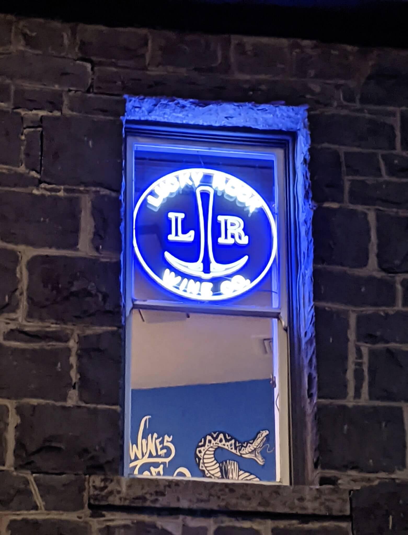 Creative Neon Sign in window
