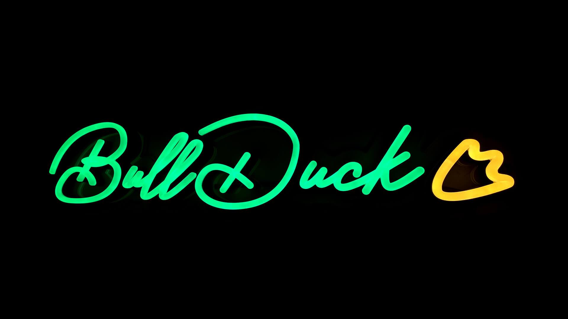 BullDuck's green and yellow neon light